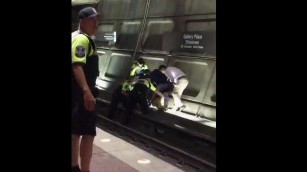 Suspect in Shooting Near Police HQ Ran Onto Metro Tracks