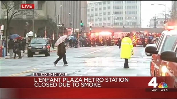 Metro Riders Exit Tunnel at L'Enfant For Smoke in Tunnel
