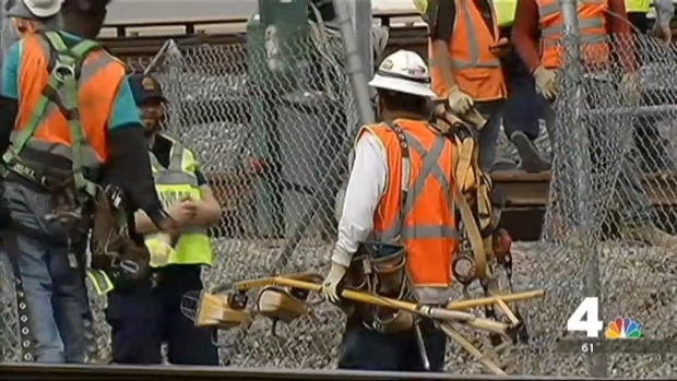 [DC] Crews Working to Clear Metro Tracks After Pedestrian Bridge Collapse