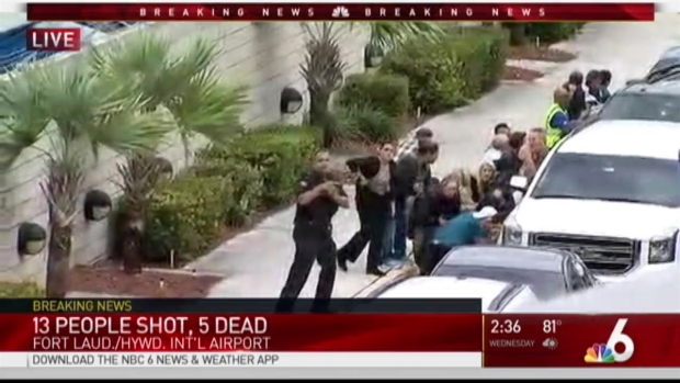 [NATL-MIA] RAW: Terminal 1 People Duck For Cover