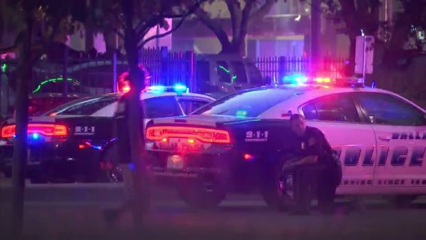 Officers Take Cover After Shots Fired Downtown