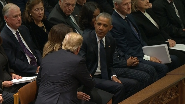 Trumps, Obamas Shake Hands at Bush Funeral