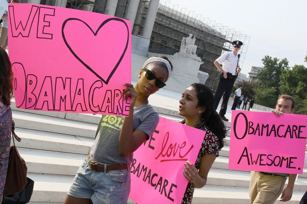 Photos: Crowds Protest, Support Health Care Ruling Outside Supreme Court