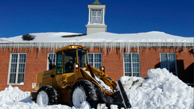 [AP] Crews Clear Snow, Help Restore Power to Thousands in New England