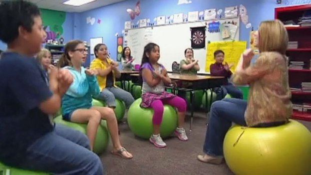 [NATL-V-DFW] Exercise Balls Replace Chairs in the Classroom