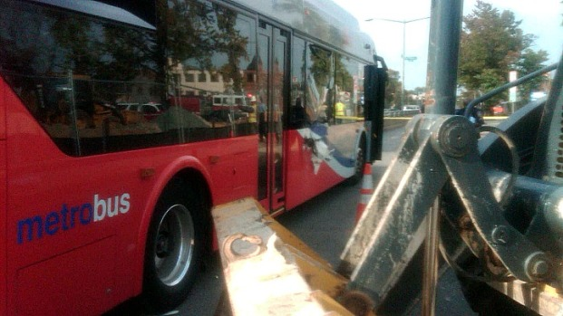 Metrobus Struck by Front-End Loader