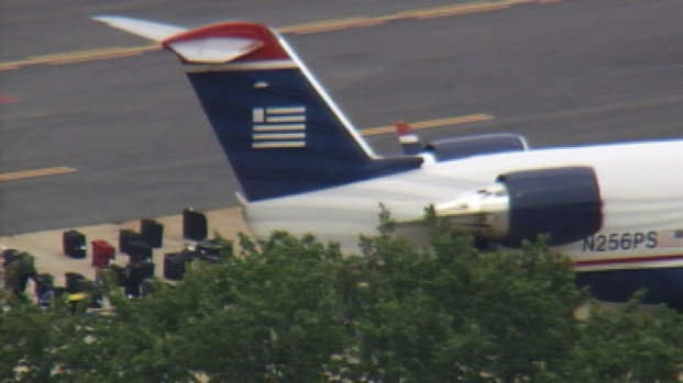 [DC] Raw Video: Bomb Tech Searching Bags at DCA