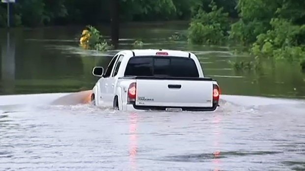 [DC] Raw Video: Truck Doubles as Boat During Flood in Bristow