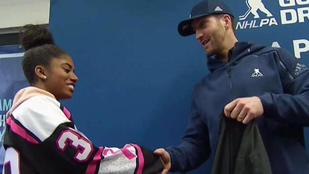 Caps' Orpik Presents Youth Hockey Team With New Equipment