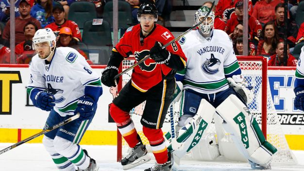 Brodie Leads Flames Past Canucks 4-2 in Game 3