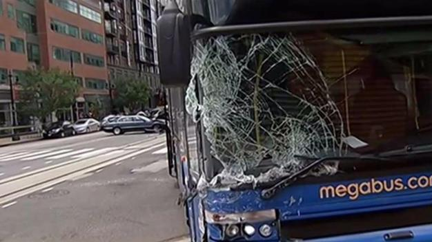 Megabus Hits, Drags Cars on H Street