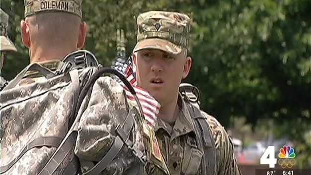 Soldiers Place American Flags at Arlington National Cemetery