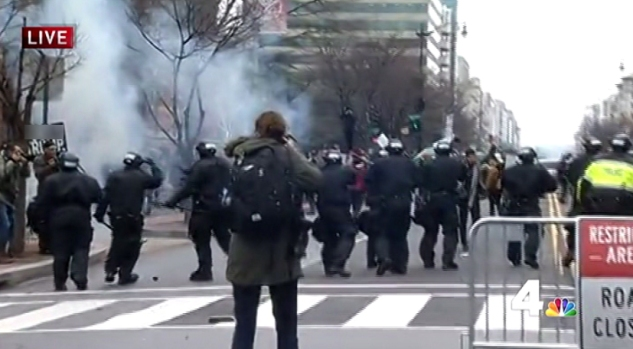 Protesters Smash Windows, Clash With 100 Officers Downtown