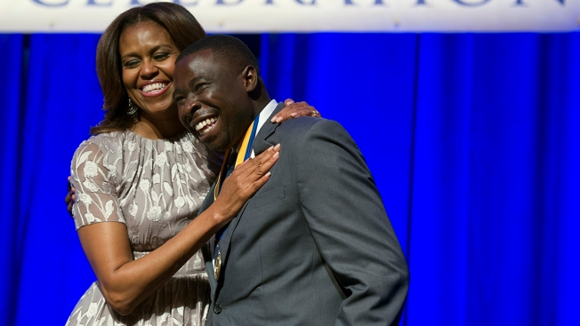 Don't Shy Away From Struggle, First Lady Tells D.C. Grads