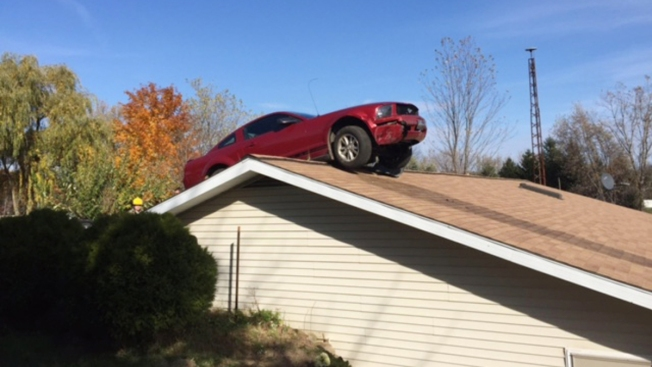 Michigan Owner Hears 'Kaboom,' Finds Car on Roof of Home