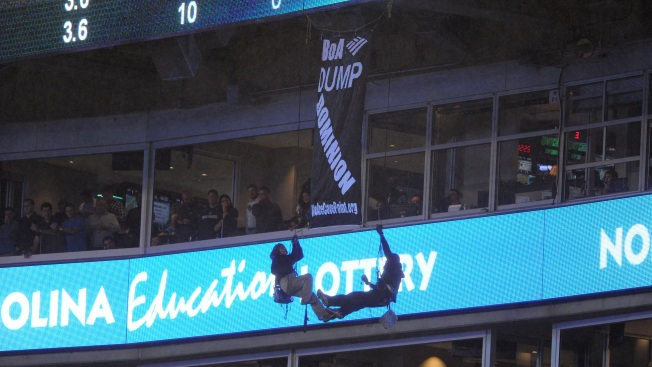 Anti-Fracking Protesters Rappel, Unfurl Banner During Monday Night Football