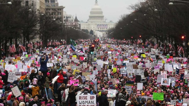 Thousands join women's marches opposing Donald Trump and sexual assault