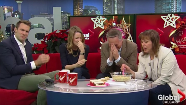 'It Burns': News Anchors Gag on Co-Worker's Holiday Artichoke Dip