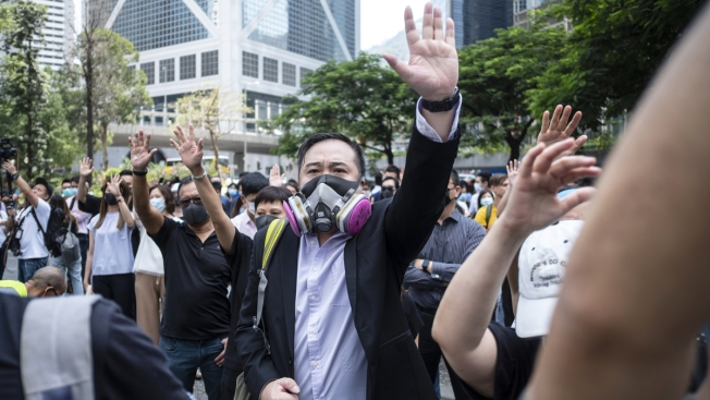 Thousands Protest Mask Ban as HK Leader Toughens Stance
