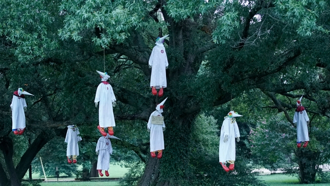 Clown dummies in KKK robes found hanging from tree in Virginia park