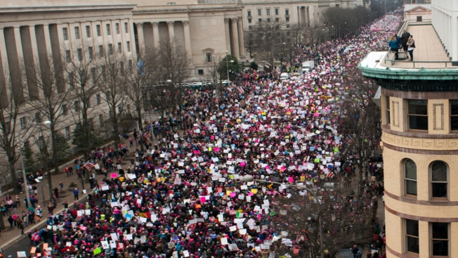 Women's Day marchers target Trump on abortion and
