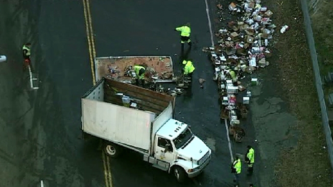 Box Truck Overturns, Spills Boxes of Alcohol in Va.