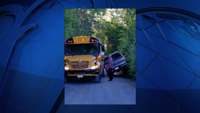 Pickup Truck Ends Up on 2 Wheels After Driver Tries to Squeeze Past Stopped School Bus