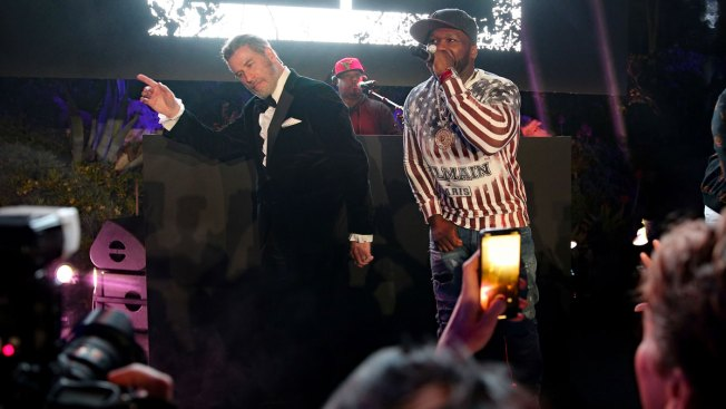 In Da Club: Travolta Dances His Way Through Cannes With 50 Cent