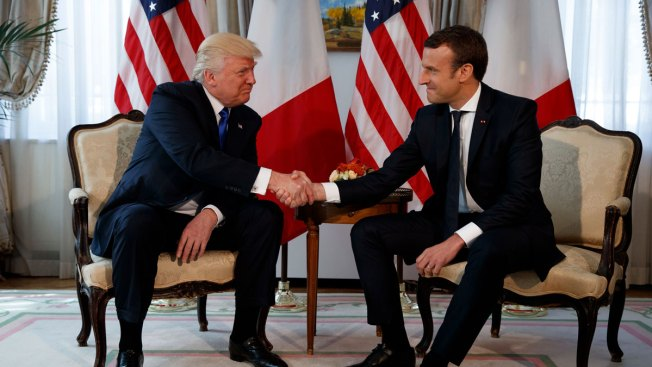 Trump, Macron handshake turns into showdown