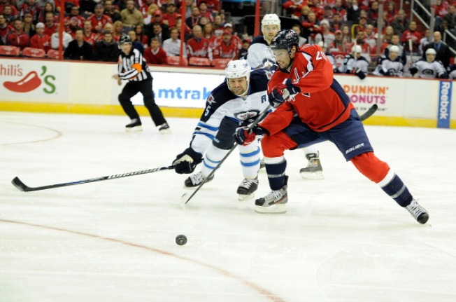 Jets' 4-2 Victory Drops Capitals, Oates to 0-2