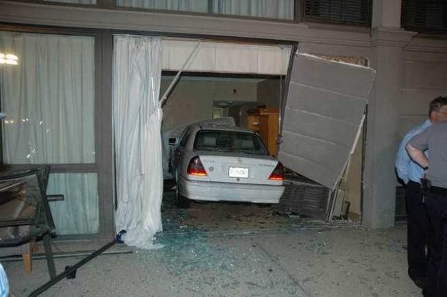 Car Crashes Into Hotel, Traps Woman