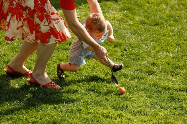 Kids Rolling Eggs on White House Lawn