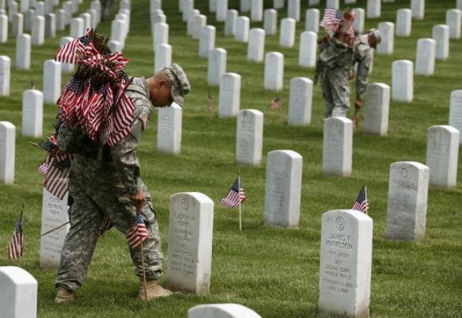 Old Guard Places Flags at Arlington National Cemetery