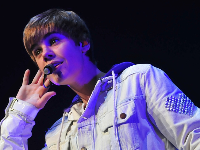 Justin Bieber Celebrates 2011 By Slapping His Friend Awake