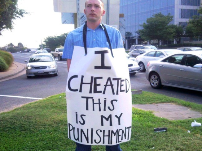 Cheating Hubby With Sign: Yep, a Hoax