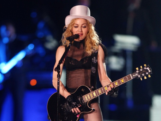 Madonna Donates Shoes to Gypsy Cause
