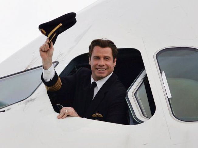 Travolta, Scientologists Help DC Charities, Haiti