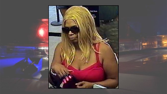 Woman in Blonde Wig Wanted in Bank Robbery