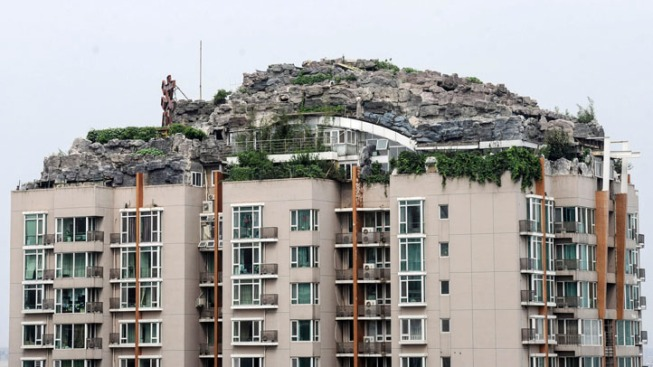 Beijing Cracks Down on Bizarre Apartment-Top Villa