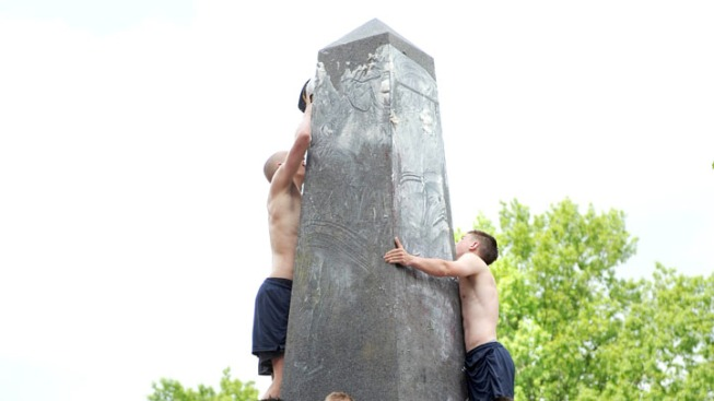 One Injured as Navy Students Climb Greased Obelisk