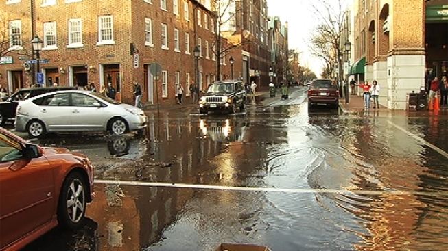 Flood Waters Sweep Through Old Town Streets