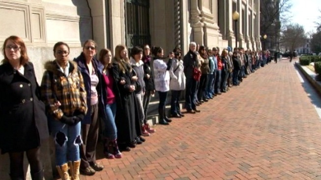 Hundreds of Women Stage Mute Protest at Va. Capitol