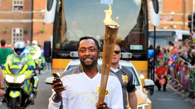 Will.i.am Carries Olympic Torch
