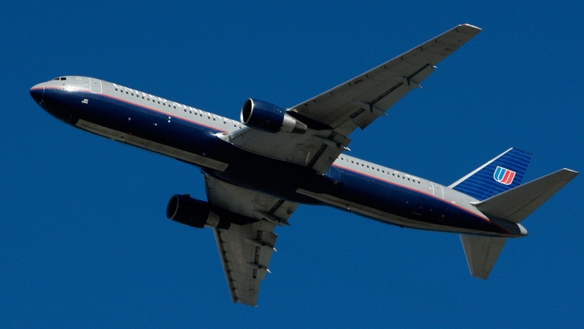 Plane Returns to Dulles After Fist Fight