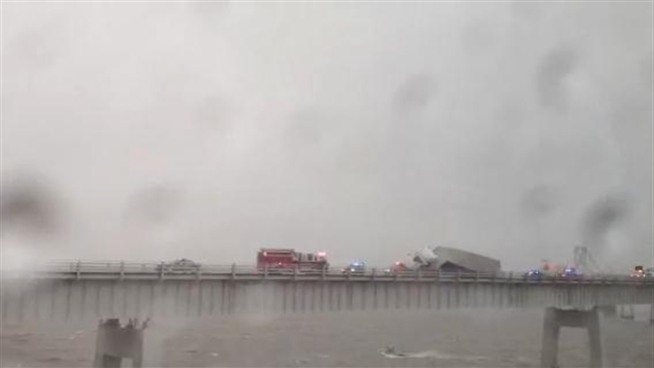 RAW VIDEO: A truck crashed on the Bay Bridge in high winds and rain March 6.