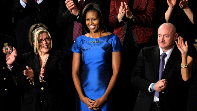 First Lady Michelle Obama wears a sapphire blue Barbara Tfank dress at the State of the Union. She also wore Tfank during a visit to Buckingham Palace last Spring.