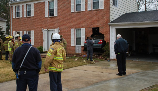 Driver Crashes Through Den of House
