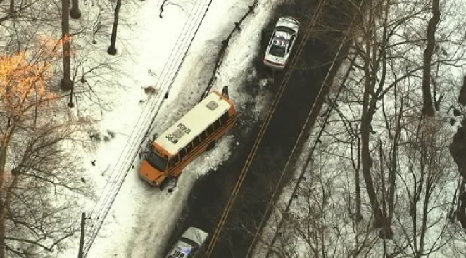 School Bus Slides Off Icy Road in Rockville