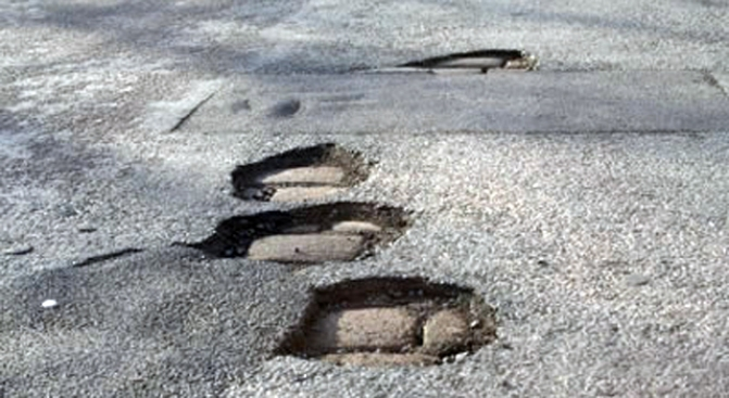Pothole Patrol: Commuters, Workers Deal With Problems