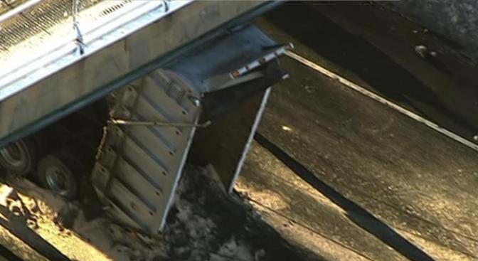 Oops! Dump Truck Gets Stuck Under Beltway Overpass